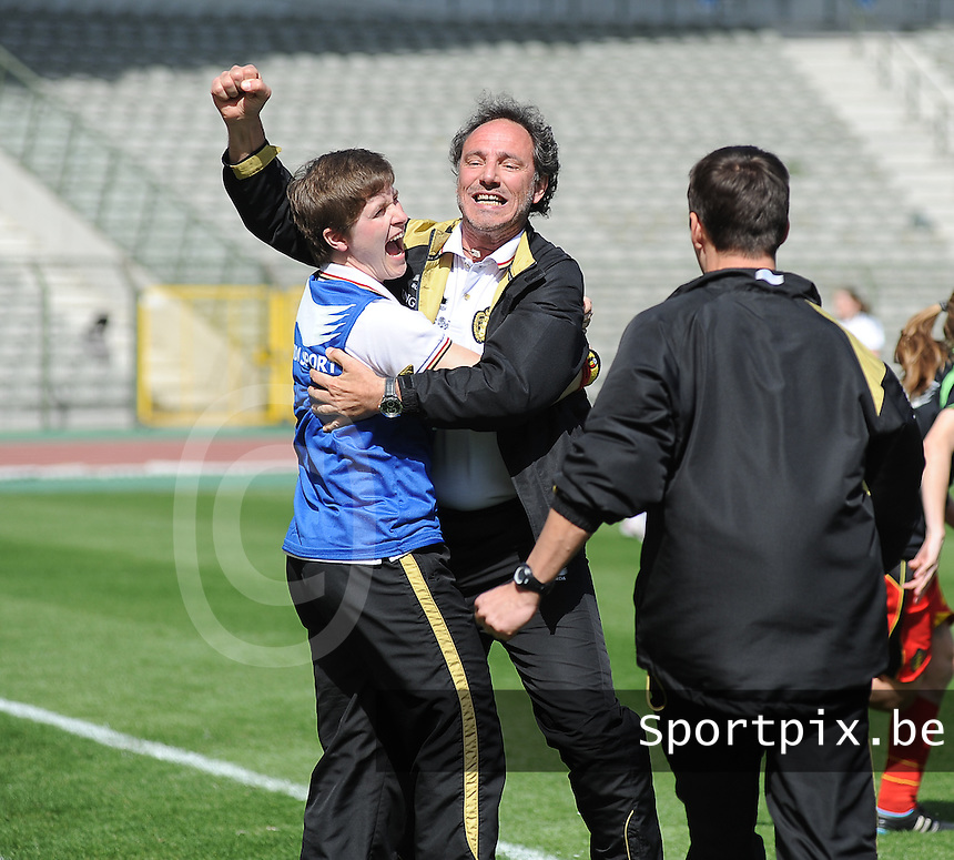 20140410 - BRUSSELS , BELGIUM : Belgian Coach Kris Van Der Haegen (middle) pictured celebrating the qualification during the female soccer match between BELGIUM U19 and GERMANY U19 , in the third and final game of the Elite round in group 4 in the UEFA European Women's Under 19 competition 2014 in the Koning Boudewijn Stadion , Thursday 10 April 2014 in Brussels . PHOTO DIRK VUYLSTEKE
