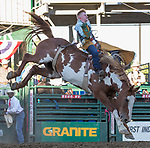 Hunter Carlson rides in the Bareback Bronc Riding event during the Reno Rodeo on Sunday, June 23, 2019.
