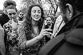 A group of Irish Traveller women argue with a Muslim man about Christianity and Islam.  Speakers Corner, Hyde Park, London,  March 2014.