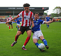 Lincoln City's Lee Angol vies for possession with Macclesfield Town's George Pilkington<br /> <br /> Photographer Andrew Vaughan/CameraSport<br /> <br /> Vanarama National League - Lincoln City v Macclesfield Town - Saturday 22nd April 2017 - Sincil Bank - Lincoln<br /> <br /> World Copyright &copy; 2017 CameraSport. All rights reserved. 43 Linden Ave. Countesthorpe. Leicester. England. LE8 5PG - Tel: +44 (0) 116 277 4147 - admin@camerasport.com - www.camerasport.com