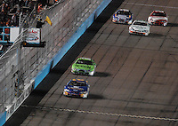 Apr 20, 2007; Avondale, AZ, USA; Nascar Busch Series driver Clint Bowyer (2) leads Matt Kenseth (17) under caution to the checkered flag to win the Bashas Supermarkets 200 at Phoenix International Raceway. Mandatory Credit: Mark J. Rebilas