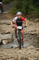 NWA Democrat-Gazette/ANDY SHUPE<br /> Robert Russell of Bentonville rides across Lee Creek Saturday, Sept. 19, 2015, during the Northwest Arkansas Mountain Bike Championships at Devil's Den State park.
