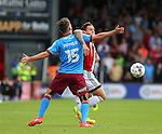 Billy Sharp of Sheffield Utd tussles with Harry Toffolo of Scunthorpe Utd during the English League One match at Glanford Park Stadium, Scunthorpe. Picture date: September 24th, 2016. Pic Simon Bellis/Sportimage