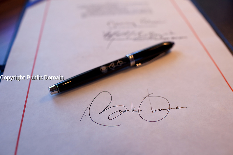Close-up detail of President Obama's signature on a bill, and a pen used for the signing, aboard Air Force One on a flight from Buckley Air Force Base, Denver Colorado to Phoenix, Arizona 2/17/09. <br /> Official White House Photo by Pete Souza