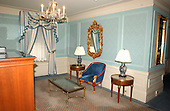"""New York, N.Y. - April 8, 2005 -- Living Room area in one of the """"mini-suites"""" at the Plaza Hotel in New York, New York on April 8, 2005.  The couch has been removed and a single chair has been put in its place.  The world renowned Plaza is scheduled to close on April 30, 2005 when renovations will begin to convert the building to condominiums. .Credit: Ron Sachs / CNP"""