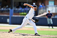 Asheville Tourists pitcher Heath Holder (26) delivers a pitch during a game against the Rome Braves at McCormick Field on July 30, 2017 in Asheville, North Carolina. The Braves defeated the Tourists 7-3. (Tony Farlow/Four Seam Images)