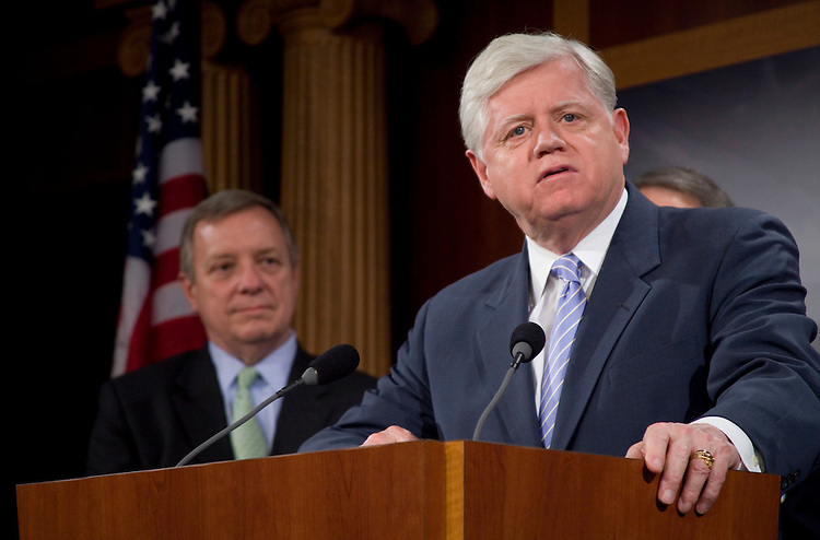 """WASHINGTON, DC - March 31: Senate Majority Whip Richard J. Durbin, D-Ill. (left) looks on as Rep. John B. Larson (D-Conn.) addresses a news conference to discuss the introduction of legislation that would """"create a voluntary system that gives congressional candidates the option to stop raising huge sums of money, giving them more time to work on the people's business. Candidates who participate in the Fair Elections process would agree to limit their campaign spending to the amounts raised from small dollar donors plus matching contributions from the Fair Elections Fund."""" (Photo by Ryan Kelly/Congressional Quarterly)"""