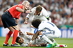 Real Madrid's Carlos Henrique Casemiro (d) injured in presence of referee Martin Atkinson (l), Sergio Ramos (c) and Marcelo Vieira (r) during Champions League 2016/2017 Semi-finals 1st leg match. May 2,2017. (ALTERPHOTOS/Acero)