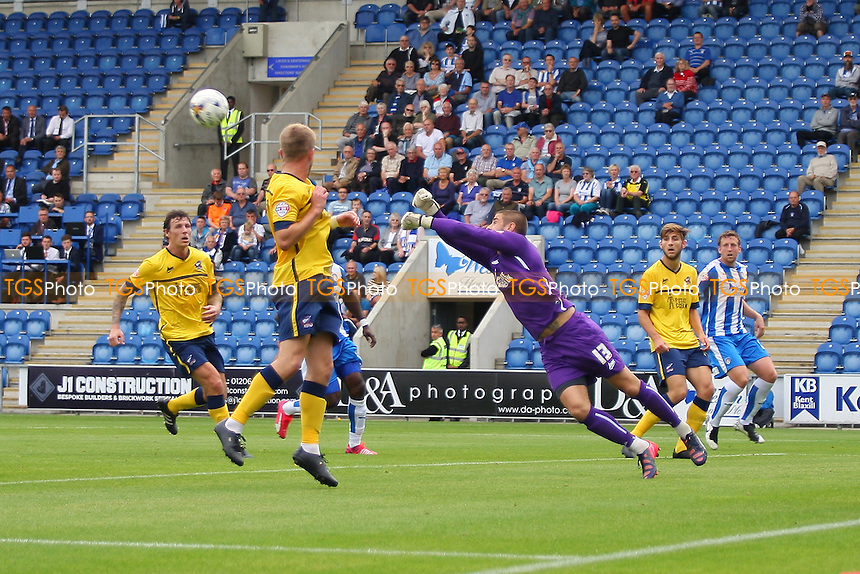 Joe Anyon of Scunthorpe United gets a fist on the ball during Colchester United vs Scunthorpe United, Sky Bet League 1 Football at the Weston Homes Community Stadium, Colchester, England on 29/08/2015