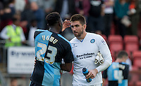 Gozie Ugwu of Wycombe Wanderers  with Goalkeeper Matt Ingram of Wycombe Wanderers at the final whistle during the Sky Bet League 2 match between Leyton Orient and Wycombe Wanderers at the Matchroom Stadium, London, England on 19 September 2015. Photo by Andy Rowland.