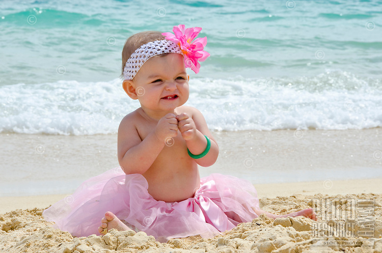 Local baby Emma in her pink tutu on the beach