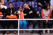 United States President Barack Obama with his wife First Lady Michelle Obama and daughters Malia and Sasha watches a college basketball game at Howard University, Saturday, November 27, 2010 in Washington, DC. President Barack Obama attended the game between Howard University and Oregon State, which is coached by his brother in law Craig Robinson..Credit: Olivier Douliery / Pool via CNP