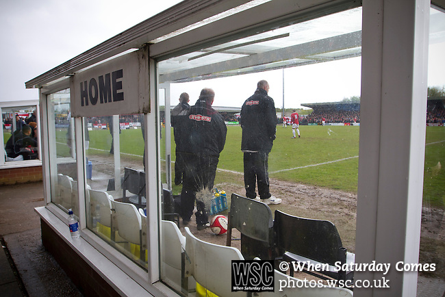 Hednesford Town 2 FC United 1, 11/05/2013. Key's Park, Northern Premier League. The home team's management pictured through the dugout at Key's Park prior to kick-off at the Hednesford Town versus FC United of Manchester Northern Premier League premier division play-off final. The match would decide which club were promoted to the Blue Square Conference North. Hednesford won the game by 2 goals to 1 in front of a stadium record attendance of 4412 spectators. Photo by Colin McPherson.