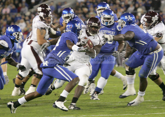 Mississippi State running back Anthony Dixon pushes through Kentucky defense in the first half of the game at Commonwealth Stadium Saturday night..Photo by Zach Brake | Staff