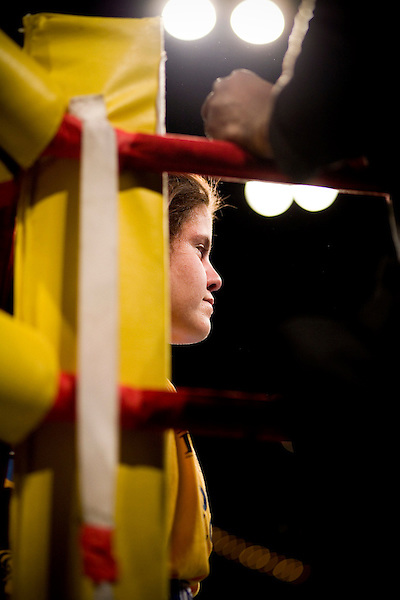 Holly Stevens waits for the verdict. She will lose.. Thursday was the first night of the finals of the  79th annual Golden Glove Boxing tournament. Boxers from all over the New York who made it through the previous rounds were on hand at Madison Square Garden to compete for the coveted Golden Gloves Champion title.