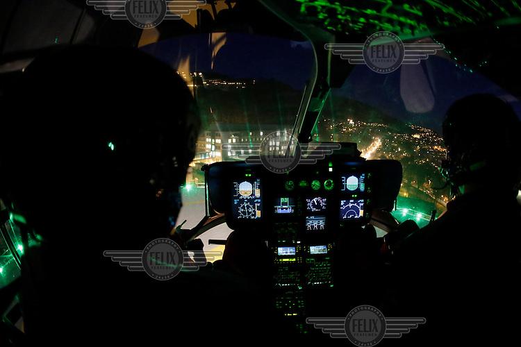 Helicopter from Norwegian Air Ambulance approaching landing pad at Haukeland hospital. <br /> <br /> Nattflyging, helikopter EC-135 inn for landing på landingsplass ved Haukeland sykehus. Bilde tatt ifm reportasje om basen i Bergen. <br /> <br /> Magasin 1/2013