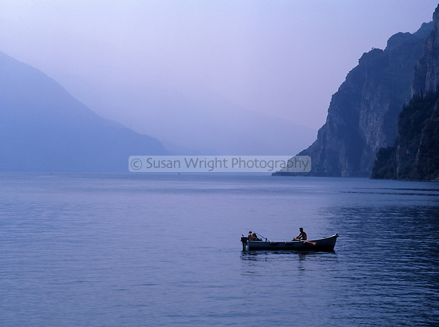 2 Fishermen in a boat on Lake Garda in the Lakes District of Italy