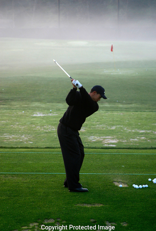 Tiger Woods gets in early morning final round practice before teeing off in the Accenture Tournament in at the La Costa Country Club and Spa in Carlsbad, CA.