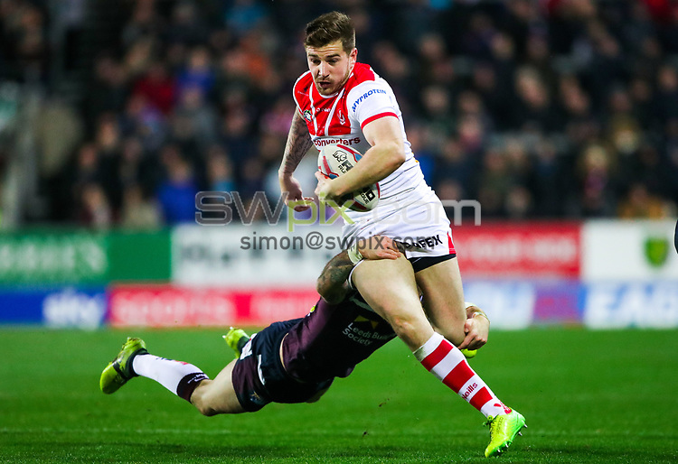 Picture by Alex Whitehead/SWpix.com - 16/03/2018 - Rugby League - Betfred Super League - St Helens v Leeds Rhinos - Totally Wicked Stadium, St Helens, England - St Helens' Mark Percival is tackled by Leeds' Richie Myler.