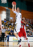 Florida International University center Gilles Dierickx (15) plays against Western Kentucky University, which won the game 61-51 on January 28, 2012 at Miami, Florida. .