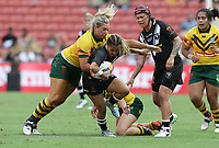 New Zealand's Nita Maynard is tackled by Australia's Ruan Sims, left, during the women's Rugby League World Cup final between Australia and New Zealand, Suncorp Stadium, Brisbane, Australia, 2 December 2017. Copyright Image: Tertius Pickard / www.photosport.nz MANDATORY CREDIT/BYLINE : Tertius Pickard/SWpix.com/PhotosportNZ