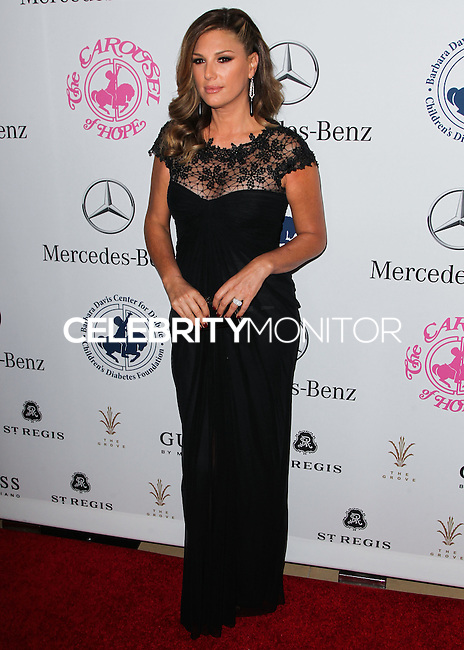 BEVERLY HILLS, CA, USA - OCTOBER 11: Daisy Fuentes arrives at the 2014 Carousel Of Hope Ball held at the Beverly Hilton Hotel on October 11, 2014 in Beverly Hills, California, United States. (Photo by Celebrity Monitor)