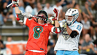 Atlas attack Kevin Unterstein (13) hits Whipsnakes midfielder John Haus (26) in the mouth with his stick and takes his helmet off as he tries to get around Haus during the Whipsnakes vs. Atlas Premier Lacrosse League (PLL) game June 22, 2019 at Homewood Field in Baltimore, MD.