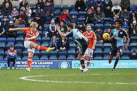 Cameron McGeehan of Luton Town (left) scores the opening goal against Wycombe Wanderers during the Sky Bet League 2 match between Wycombe Wanderers and Luton Town at Adams Park, High Wycombe, England on 6 February 2016. Photo by David Horn.
