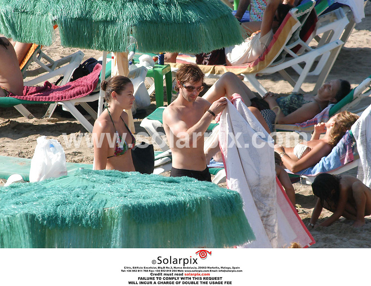 ALL ROUND PICTURES BY SOLARPIX.COM 09.08.06.There was no sign of Petra Nemcova as James Blunt became intimate and cosy with a mystery brunette on a Spanish beach yesterday.  JOB REF:2697-MAD..MUST CREDIT SOLARPIX.COM OR DOUBLE FEE WILL BE CHARGED......