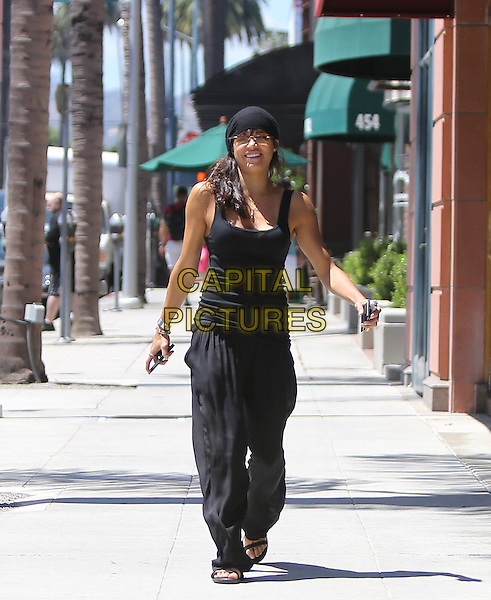 July 26, 2013 Beverly Hills California Michelle Rodriguez leaving a nail salon in Beverly Hills looking very happy on a sunny day in California <br /> CAP/MPI/JM<br /> &copy;John Misa/MediaPunch/Capital Pictures