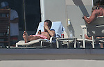 July 22nd 2012  Exclusive <br /> <br /> Scott Disick text messaging on his phone wearing a pink pair of swimsuit shorts gold watch drinking a Tecate beer laying down tanning shirtless talking to friends at a Malibu beach house <br /> <br /> <br /> AbilityFilms@yahoo.com<br /> 805 427 3519<br /> www.AbilityFilms.com