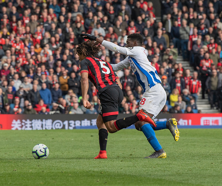 Brighton & Hove Albion's Yves Bissouma (right)  shows his sides frustration as he grabs Bournemouth's Nathan Ake (left) is grabbed from behind<br /> <br /> Photographer David Horton/CameraSport<br /> <br /> The Premier League - Brighton and Hove Albion v Bournemouth - Saturday 13th April 2019 - The Amex Stadium - Brighton<br /> <br /> World Copyright © 2019 CameraSport. All rights reserved. 43 Linden Ave. Countesthorpe. Leicester. England. LE8 5PG - Tel: +44 (0) 116 277 4147 - admin@camerasport.com - www.camerasport.com