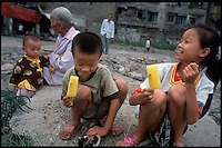 Fengdu, China, August 2003.Children playing in the old city of Fengdu, soon to be destroyed before the Three Gorges Dam project can be completed.