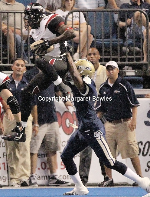 05 June 2010: Oklahoma City wide receiver Anthony Hines goes up for a touchdown pass as Tampa's Daryon Brutley defends. The Tampa Bay Storm defeated the Oklahoma City Yard Dawgz 50-48 at the St. Pete Forum in Tampa, Florida