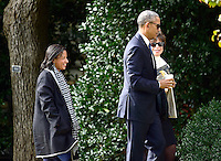 United States President Barack Obama returns to the White House after making remarks in the Memorial Amphitheater at Arlington National Cemetery in Arlington, Virginia after laying a wreath at the Tomb of the Unknown Soldier on Veteran's Day, Friday, November 11, 2016.  At left is Assistant to the President for National Security Affairs (National Security Advisor) Susan Rice and at right is Senior Advisor to the President of the United States and Assistant to the President for Public Engagement and Intergovernmental Affairs Valerie Jarrett.<br /> Credit: Ron Sachs / Pool via CNP /MediaPunch