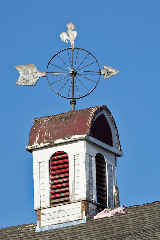 Wheel weather vane on barn. Eastern Washington.
