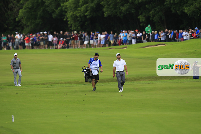 Francesco Molinari (ITA) walking down the 18th fairway during Round 4 of The BMW PGA Championship  at Wentworth Golf Club on Sunday 28th May 2017.<br /> Photo: Golffile / Thos Caffrey.<br /> <br /> All photo usage must carry mandatory copyright credit     (&copy; Golffile | Thos Caffrey)