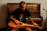 Musician Ben Harper holds a Hawaiin guitar at his studio in Santa Monica, California, U.S. December 7, 2012 ©Jonathan Alcorn/JTA