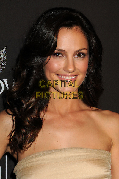 MINKA KELLY.Attending the 12th Annual Costume Designers Guild Awards held at the Beverly Hilton Hotel.  .Beverly Hills, California, USA,  .25th February 2010 .arrivals portrait headshot beige gold strapless smiling .CAP/ADM/BP.©Byron Purvis/AdMedia/Capital Pictures.