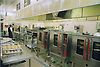 Interior photo of hospital kitchens showing industrial sized ovens,