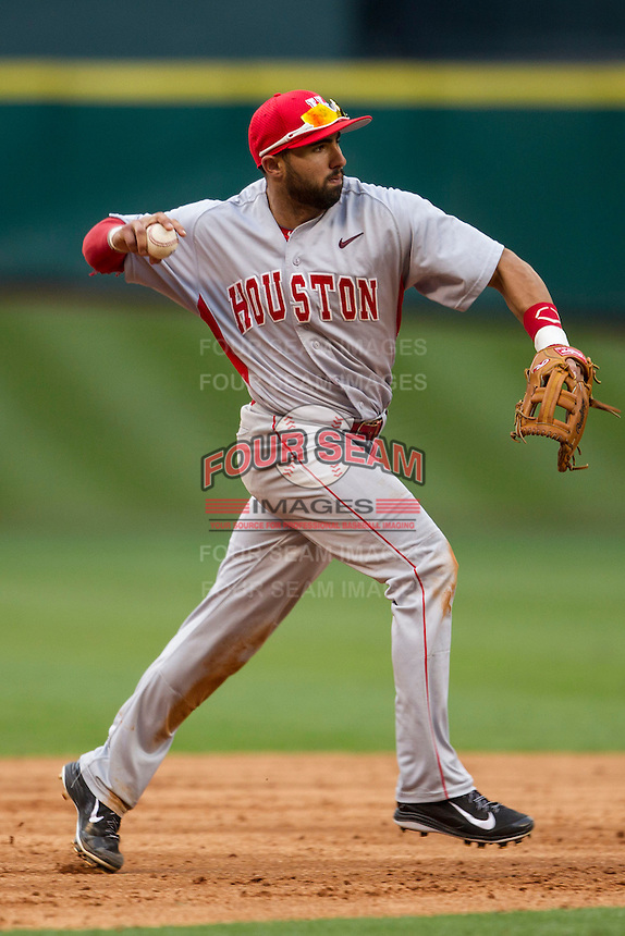 Houston Cougars shortstop Frankie Ratcliff #7 makes a throw to first base during the NCAA baseball game against the Texas Longhorns on March 1, 2014 during the Houston College Classic at Minute Maid Park in Houston, Texas. The Longhorns defeated the Cougars 3-2. (Andrew Woolley/Four Seam Images)