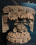 A large ceramic effigy from the ruins of the Zapotec city of Atzompa in the Museo Comunitario Santa Maria Atzompa, Oaxaca, Mexico.  Symbols on the headdress represent corn or maize and water.