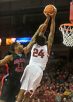 NWA Media/Michael Woods --11/21/2014-- w @NWAMICHAELW...University of Arkansas forward Michael Qualls drives to the hoop past Delaware State defender DeAndre Haywood during the first half of Friday nights game  against Delaware State at Bud Walton Arena in Fayetteville.