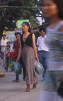 "Women in a street of Huang Beiling, also known as ""Second Wife Village"" in Shenzhen, China. The ""village"" is famous for the number of second wives  living there that cater either to wealthy local men or Hong Kong men that live just across the border and visit on weekends. ..PHOTO BY SINOPIX"