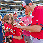 22 August 2015: Washington Nationals infielder Trea Turner signs autographs prior to a game against the Milwaukee Brewers at Nationals Park in Washington, DC. The Nationals defeated the Brewers 6-1 in the second game of their 3-game weekend series. Mandatory Credit: Ed Wolfstein Photo *** RAW (NEF) Image File Available ***