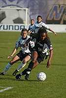 Tammy Pearman of the New York Power controls the ball against Brandi Chastain of the San Jose CyberRays during their May 5th match at Mitchell Athletic Complex. The CyberRays won 1-0.
