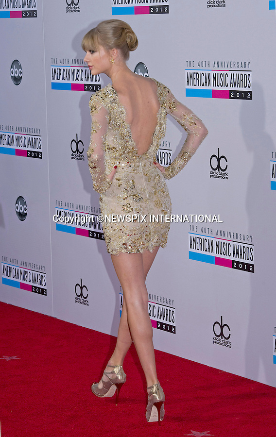 """TAYLOR SWIFT.attends the 40th American Music Awards, Nokia Theatre, Los Angeles_18/11/2012.Mandatory Photo Credit: ©Francis Dias/Newspix International..**ALL FEES PAYABLE TO: """"NEWSPIX INTERNATIONAL""""**..PHOTO CREDIT MANDATORY!!: NEWSPIX INTERNATIONAL(Failure to credit will incur a surcharge of 100% of reproduction fees)..IMMEDIATE CONFIRMATION OF USAGE REQUIRED:.Newspix International, 31 Chinnery Hill, Bishop's Stortford, ENGLAND CM23 3PS.Tel:+441279 324672  ; Fax: +441279656877.Mobile:  0777568 1153.e-mail: info@newspixinternational.co.uk"""