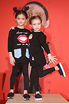 Models pose in outfits outfit from the Mon Doux Monde collection during the petitePARADE fashion show at Children's Club in the Jacob Javits Center in New York City on February 25, 2018.