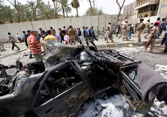 BAGHDAD, IRAQ:  The aftermath of a car bomb outside the Iranian Embassy..Three car bombs hit the centre of the Iraqi capital, Baghdad, in quick succession, killing at least 30 people and injuring about 160 people.  The bombs appeared to target the Iranian embassy, and the Egyptian, Syrian and German missions in Iraq..