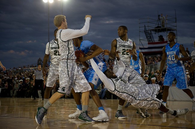 SAN DIEGO, CA - NOVEMBER 11, 2011: John Henson (31) of the North Carolina Tar Heels surrounded by Austin Thornton (13), Branden Dawson (22) and Draymond Green (10) of the Michigan State Spartans during the 2011 Quicken Loans Carrier Classic on the USS Carl Vinson..(Photo by Scott Clarke / ESPN)..- RAW FILE AVAILABLE -.- CMI000165171.jpg -